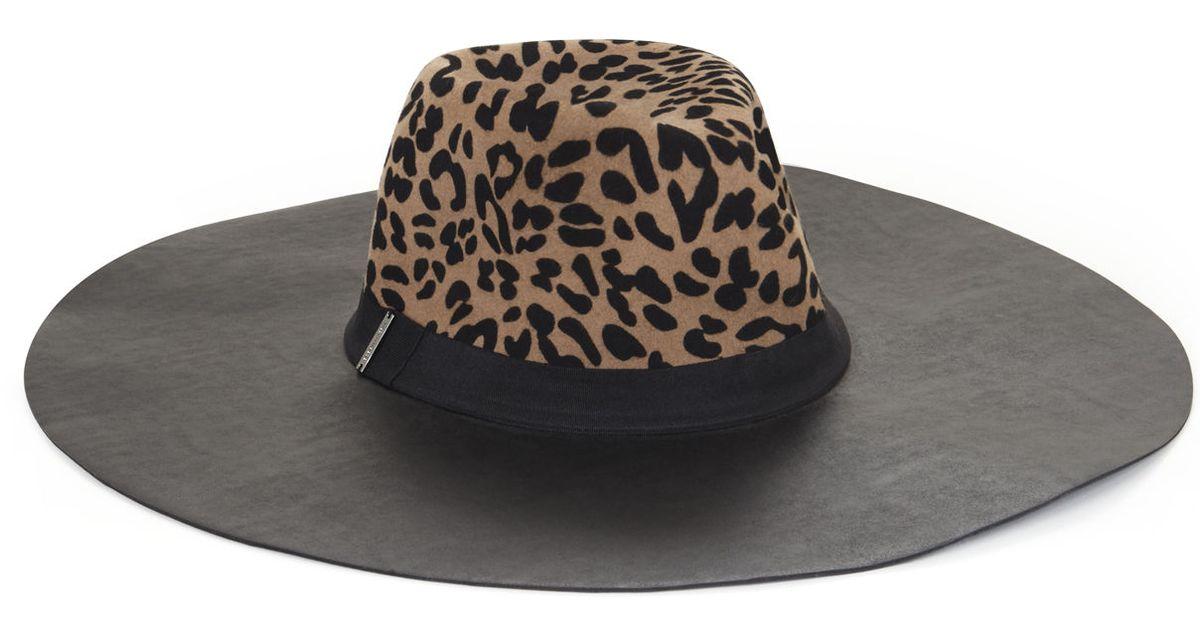 0aeef293ad609 Lyst - BCBGMAXAZRIA Leopard Printed Floppy Hat in Natural