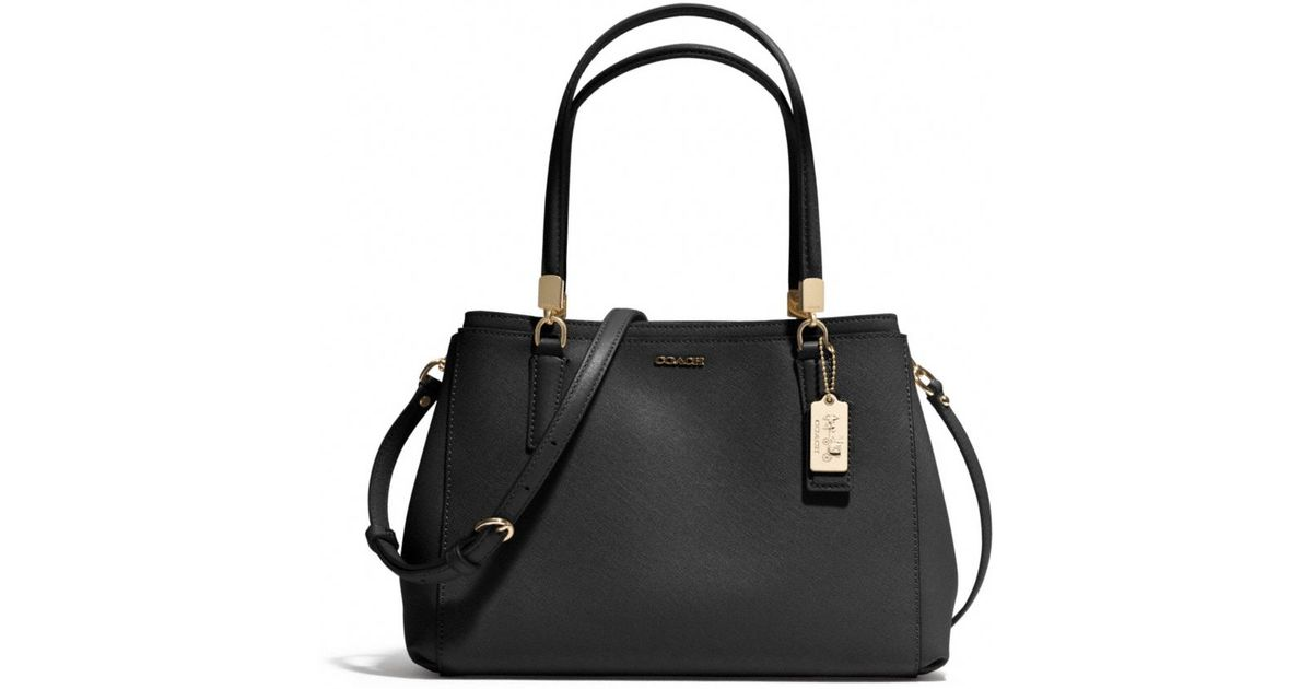 6dafd33496 ... order lyst coach madison small christie carryall in saffiano leather in  black bfbb2 df2e7