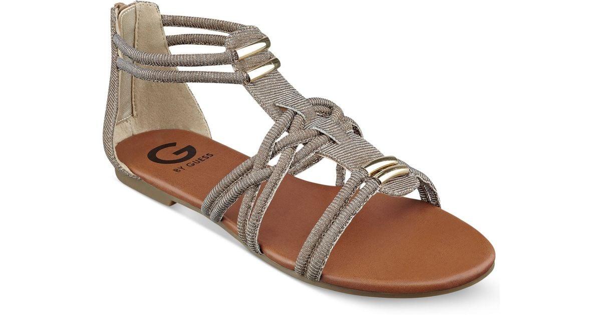 de1065d3a64f Lyst - G by Guess Women s Learn Flat Gladiator Sandals in Metallic