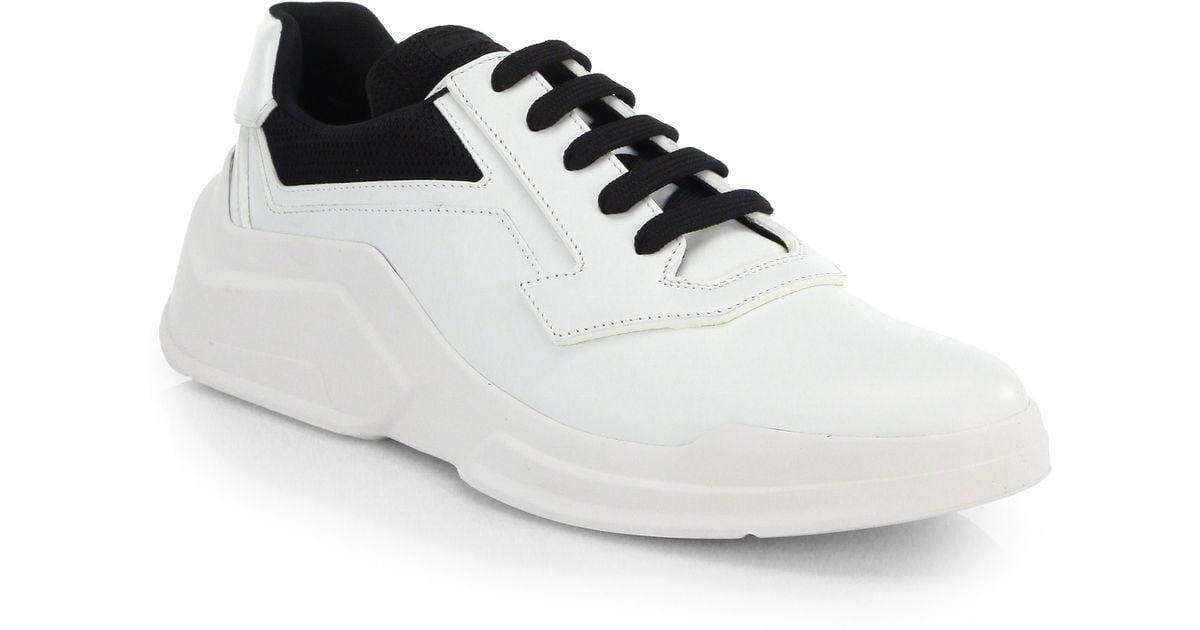 91e6545e5cf6 ... wholesale lyst prada spazzolato laced runway sneakers in white for men  c6603 f1779