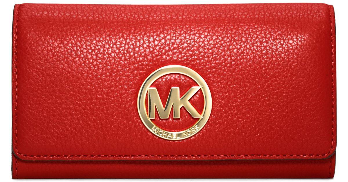 9e03860cbb37 ... sweden lyst michael kors michael fulton carryall wallet in red a3687  e71d2