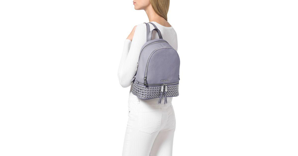 ff436be5bfbf ... new zealand lyst michael michael kors medium rhea zip grommet backpack  in purple 284e8 5f920