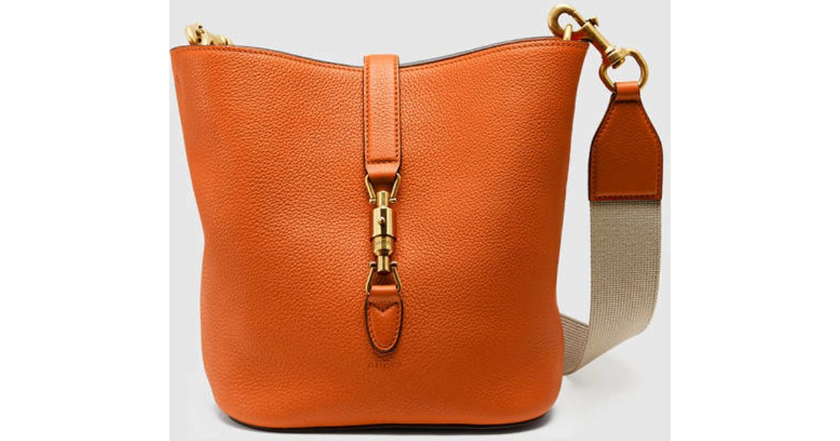 a4cea12172d671 Gucci Jackie Soft Leather Bucket Bag in Orange - Lyst