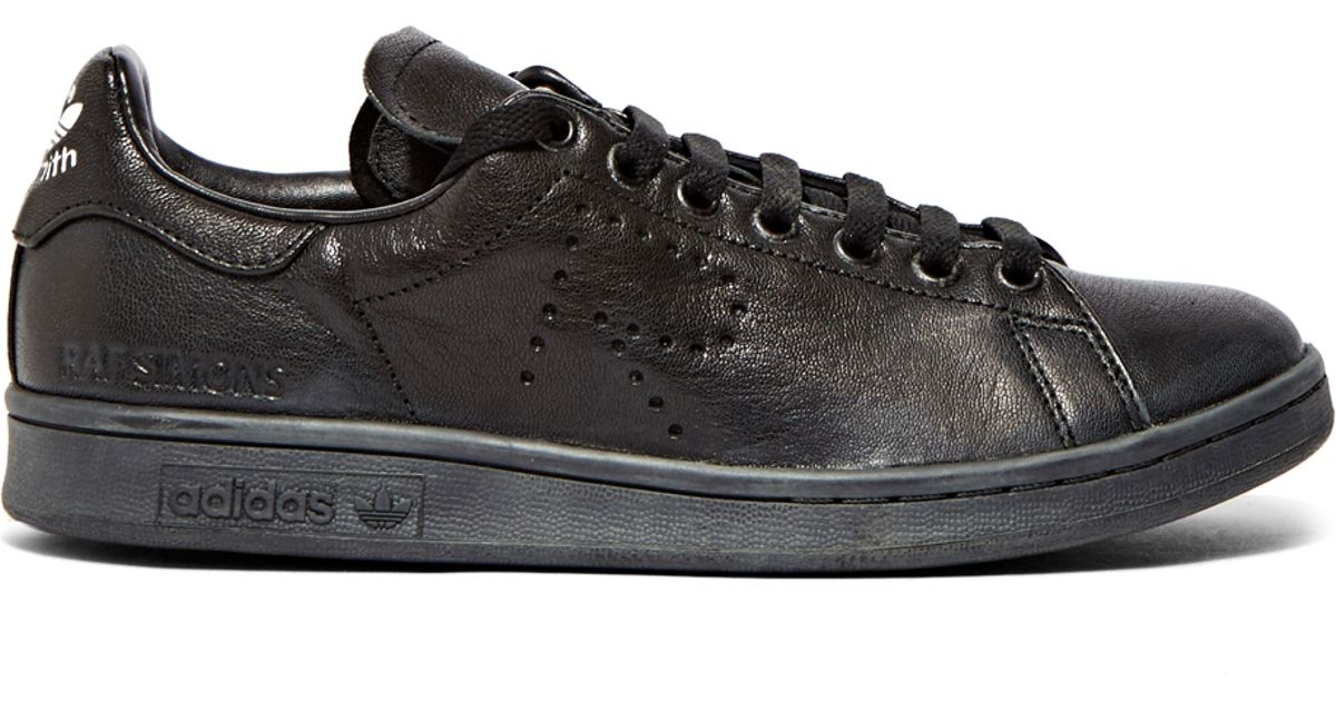 huge selection of 78544 01201 Raf Simons Black Aged Stan Smith Sneakers for men