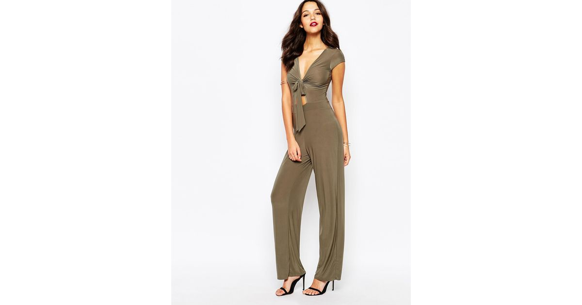 86b5fd201fa4 Lyst - Boohoo Slinky Tie Front Cut Out Jumpsuit in Natural