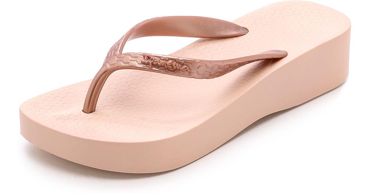 5bd030c46f9c0 Lyst - Ipanema Tropical Wedge Flip Flops - Rose Gold in Pink