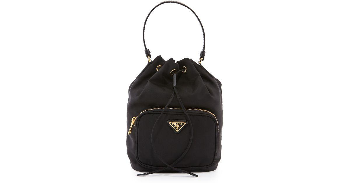 ac0e5ee525ee ... low price lyst prada tessuto mini bucket bag in black f0415 41315