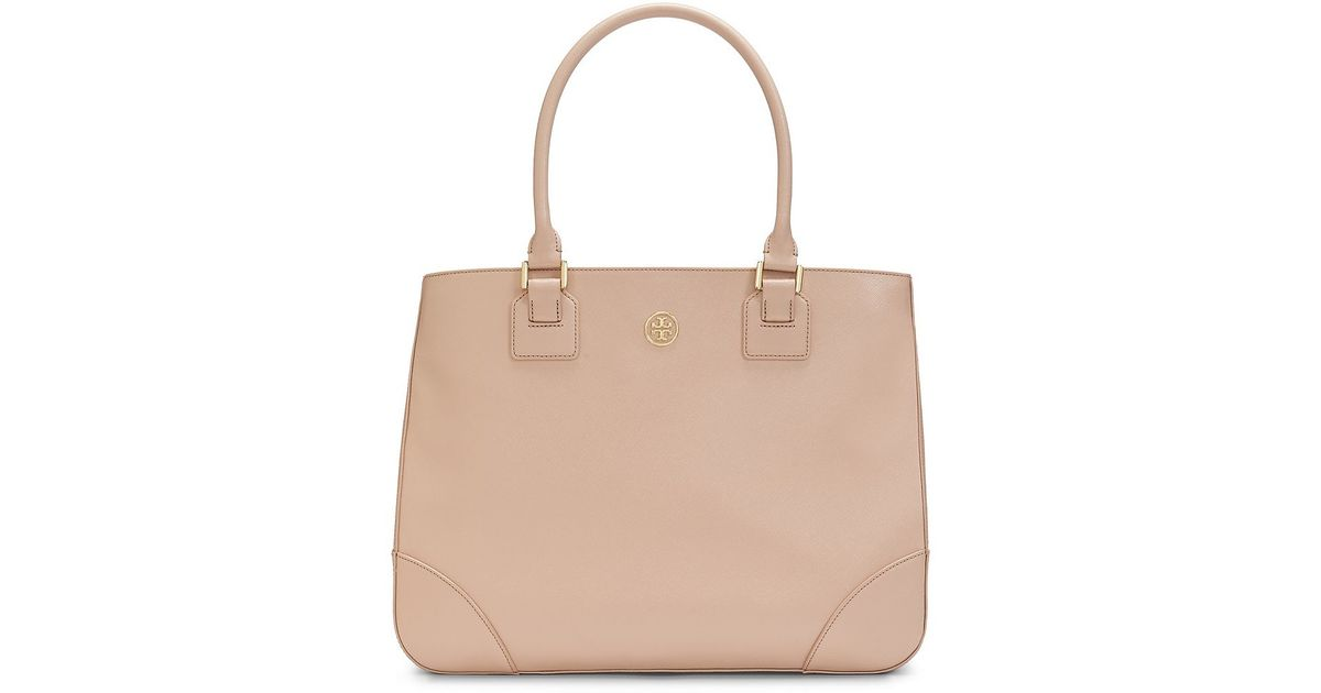 fa284a0881c ... it instantly takes your style uptown and inspire fashion envy  everywhere you go. Exterior featuring rolled leather handles