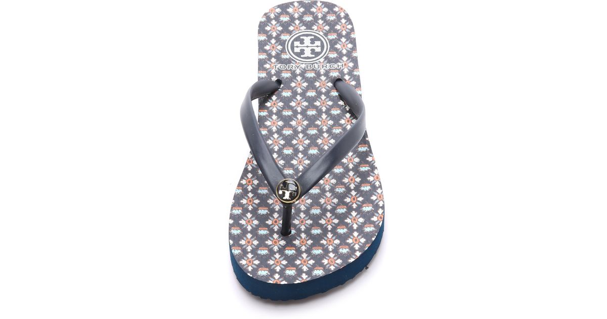 238c9f51ef899 Lyst - Tory Burch Thin Flip Flops - Tory Navy Brent in Blue