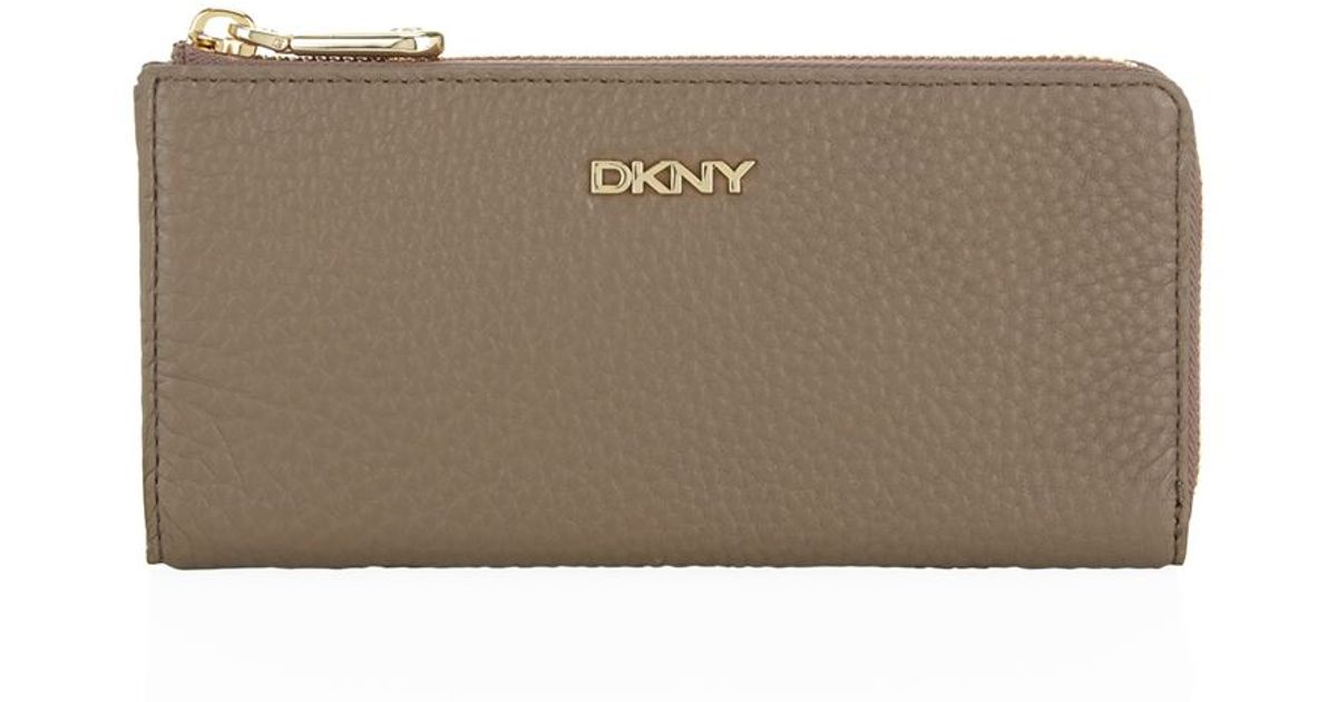72f7bd92df82 DKNY Tribeca Tumbled Leather Half Zip Wallet in Natural - Lyst