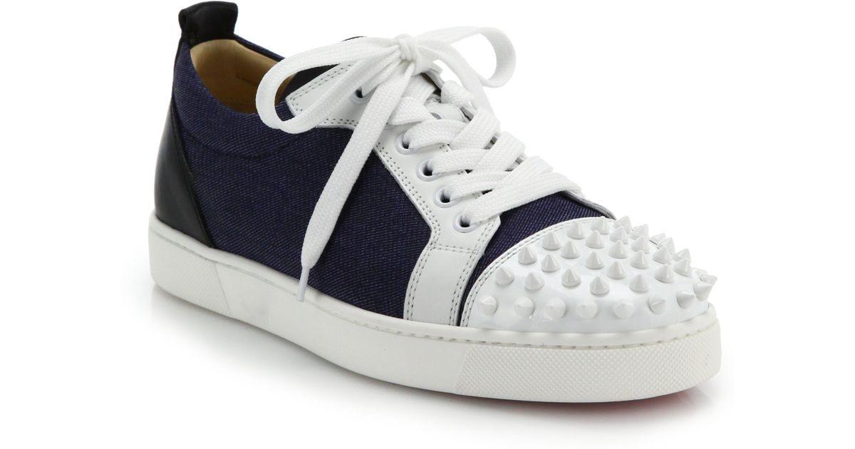 separation shoes 6c05e 2829d Christian Louboutin Blue Louis Jr Studded Leather & Denim Sneakers