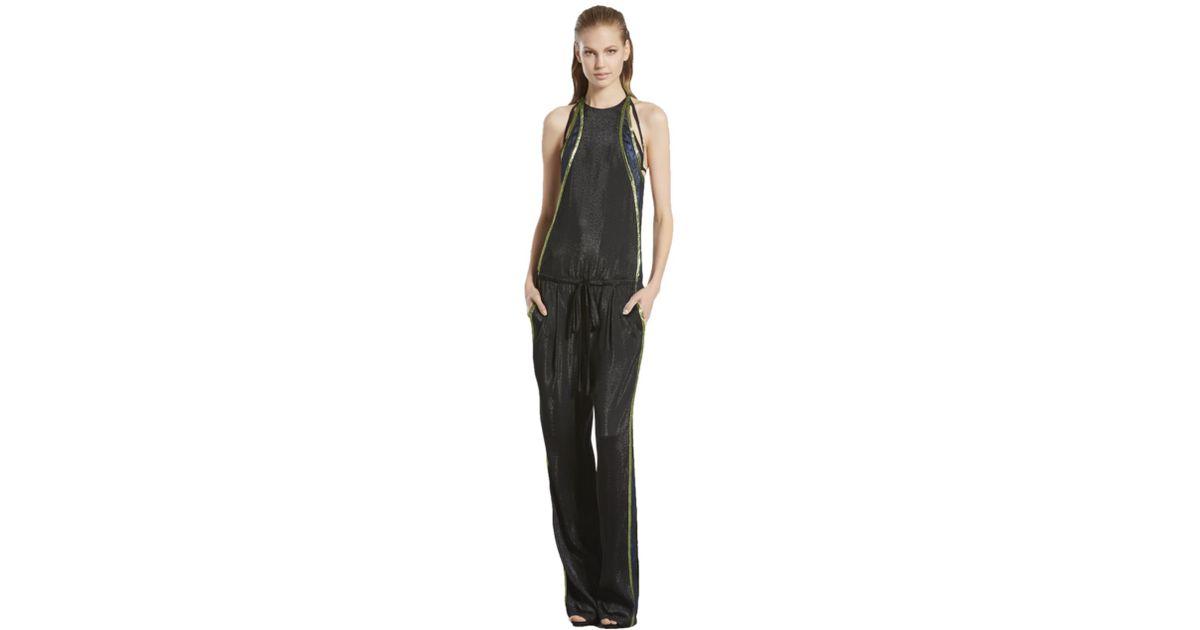 51f1e85879f Gucci Liquid Lame Jumpsuit in Black - Lyst