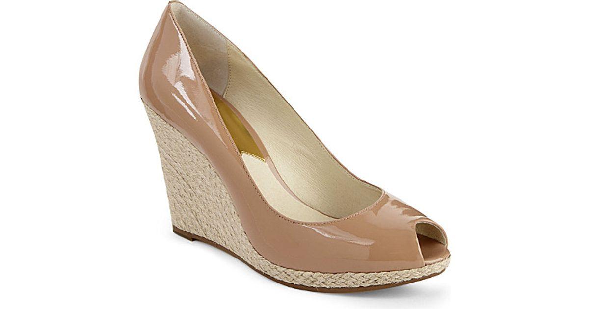 fbc70d13a3b4c Michael Michael Kors Keegan Patent Leather Wedge Sandals in Brown - Lyst