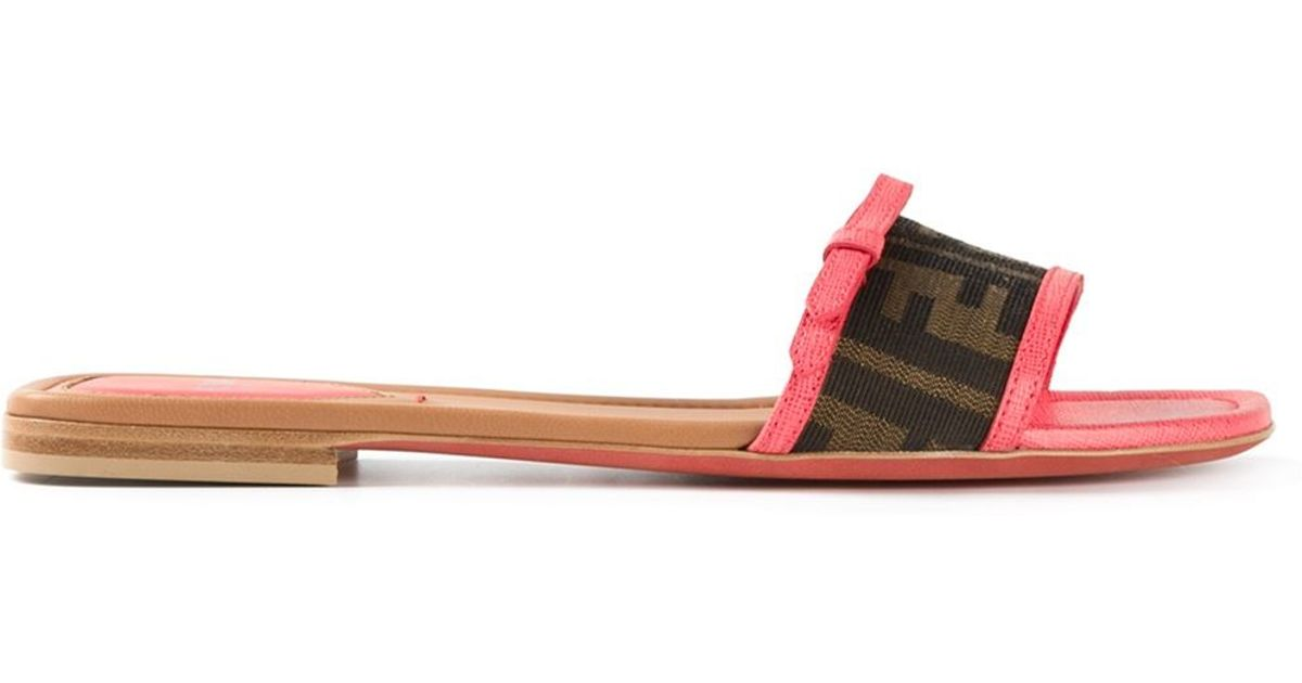 6a4d3b56bb1c Lyst - Fendi FF Logo Flip-Flops in Brown