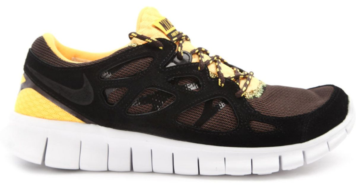 4577f7b7e41d Nike Free Run 2 Black and Yellow Sneakers in Black for Men