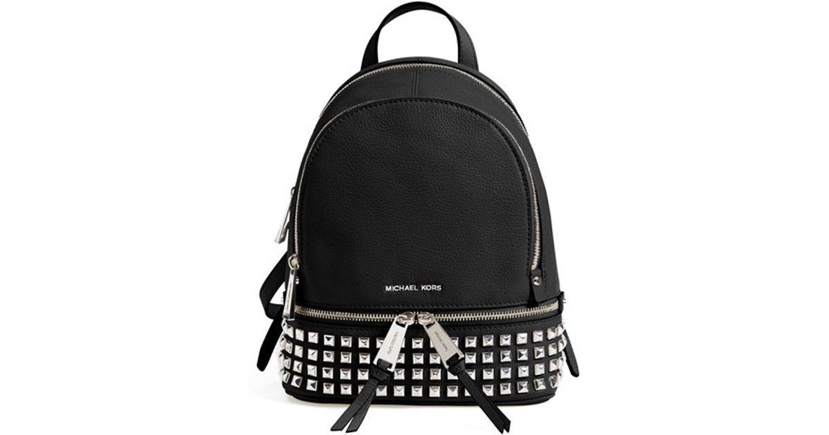 7fb8f4973cf3 Lyst - MICHAEL Michael Kors  small Rhea Zip  Studded Backpack in Black