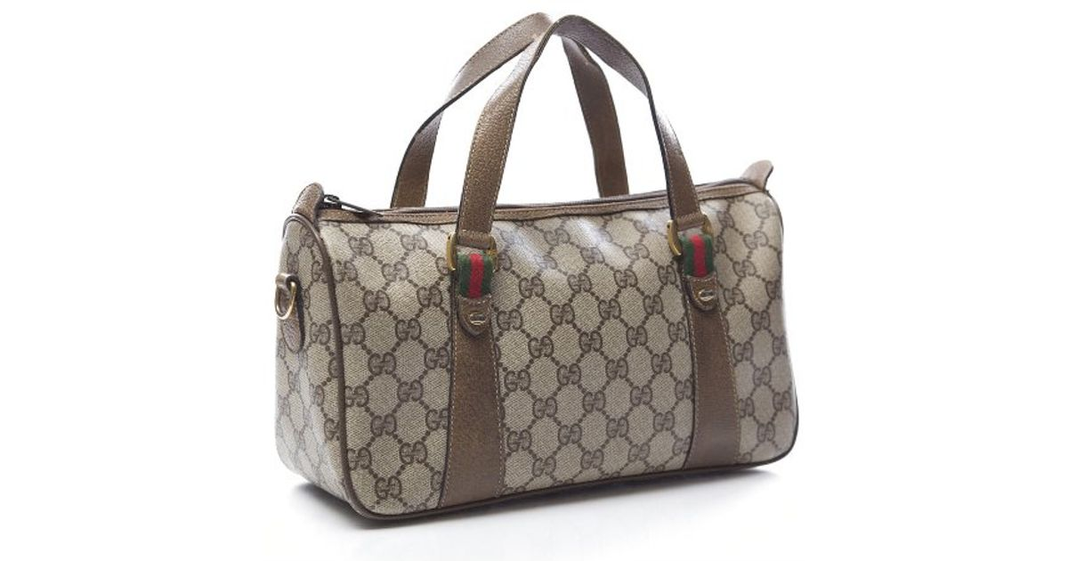 Lyst - Gucci Pre-Owned Vintage Monogram Canvas Webbed Doctor Bag in Natural a5b463fcd