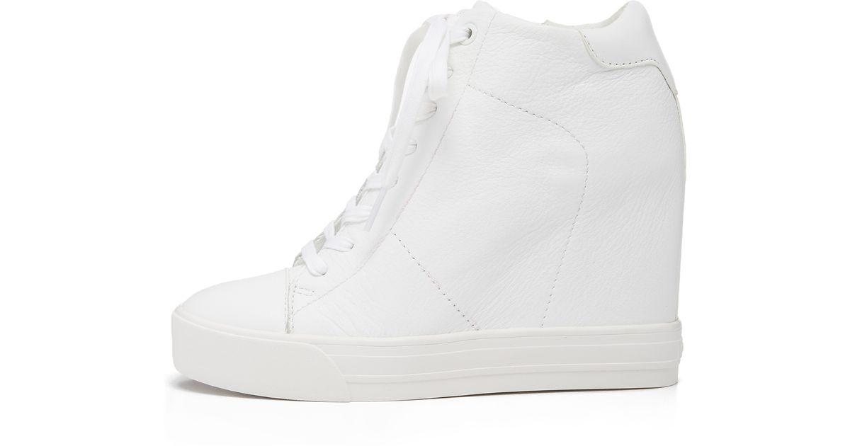 3809ea689a6d DKNY White Ginnie Wedge Sneakers