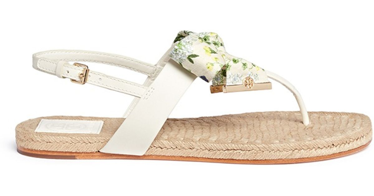 993adf022cd4 ... discount lyst tory burch penny floral print bow thong espadrille sandals  in white 086d2 c040d