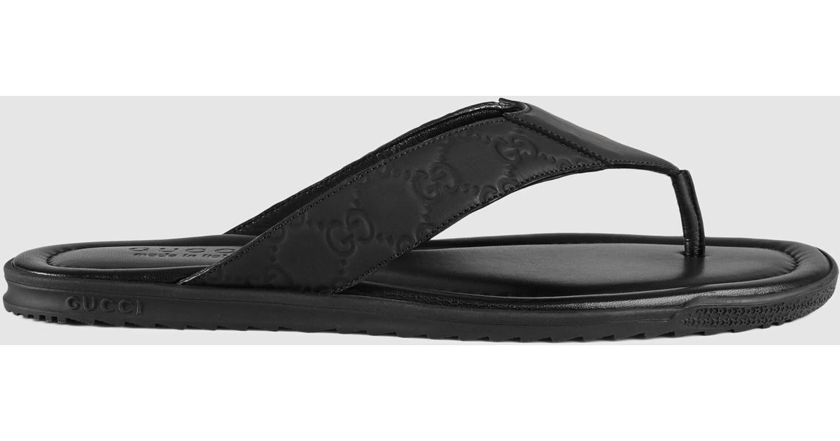 ed02569c735 Lyst - Gucci Rubberized Leather Thong Sandal in Black for Men