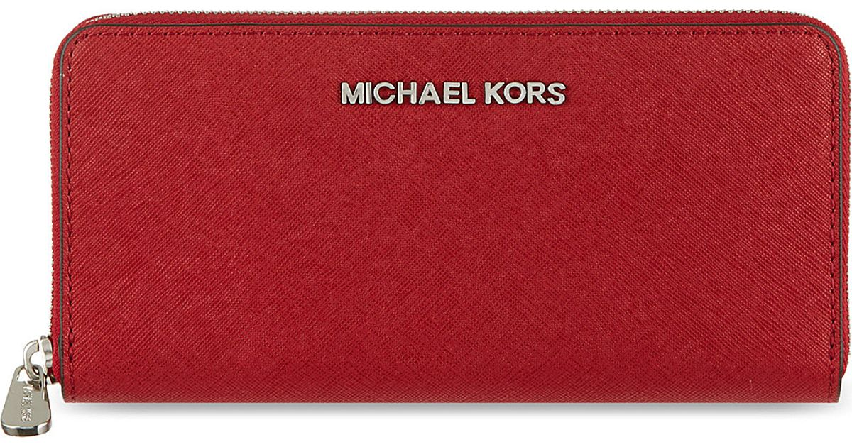 04d06d72a5f7 MICHAEL Michael Kors Jet Set Zip Around Continental Travel Wallet Scarlet  in Red - Lyst