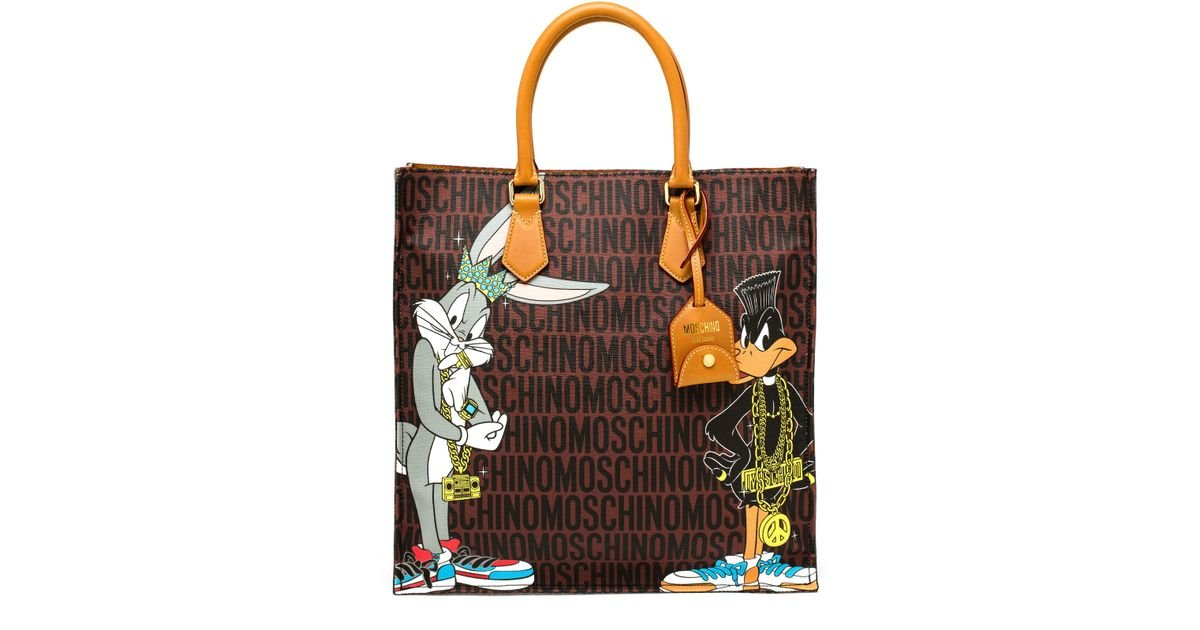 moschino bugs bunny and duffy duck printed tote in brown lyst. Black Bedroom Furniture Sets. Home Design Ideas