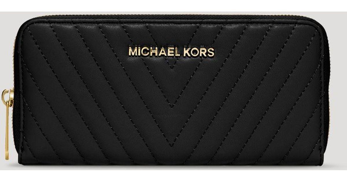 e14b8294272e MICHAEL Michael Kors Wallet - Chevron Quilted Susannah Zip Around  Continental in Black - Lyst