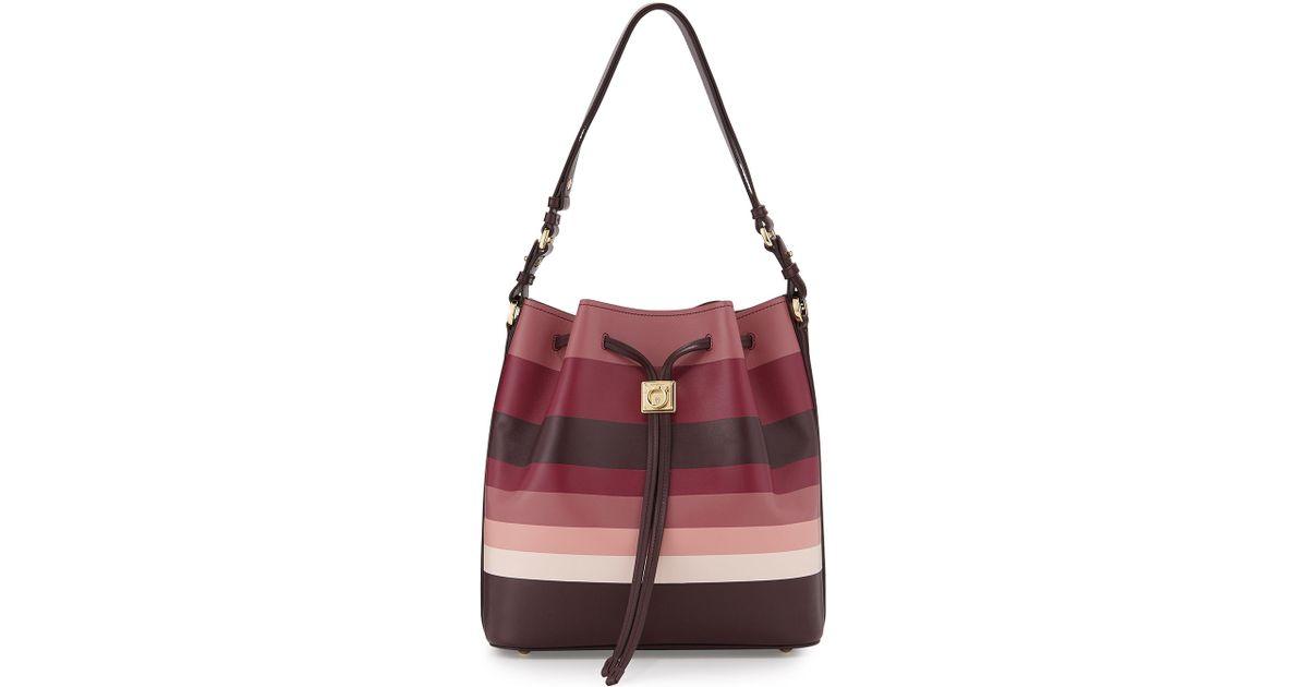 Lyst - Ferragamo Sansy Striped Leather Bucket Bag in Pink 0f69e54463e90