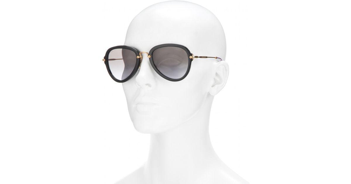 4173cce51 Miu Miu Aviator Sunglasses in Black - Lyst