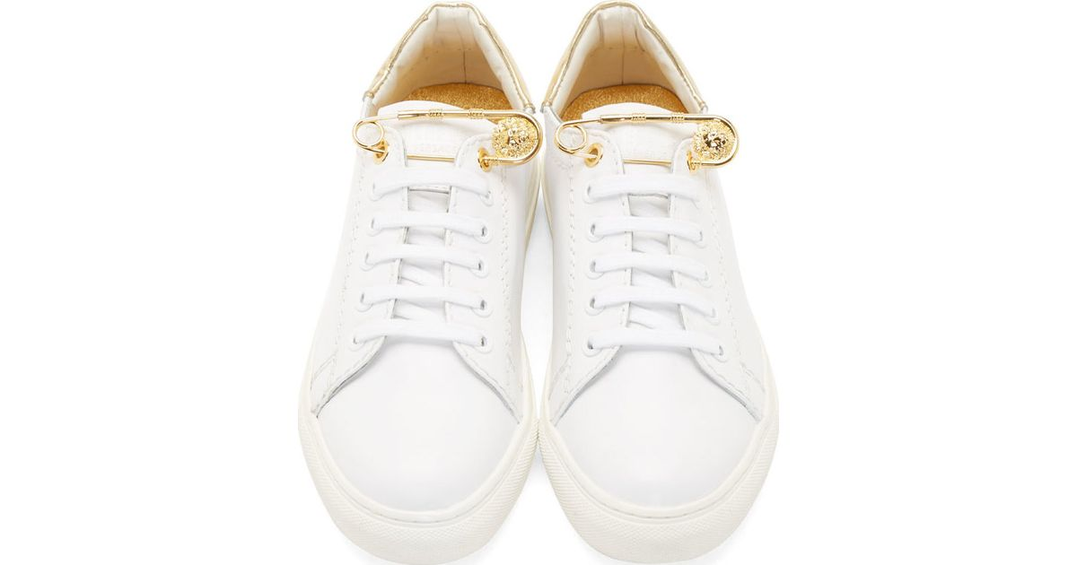 f7df604cbb9b Lyst - Versus White And Gold Safety Pin Sneakers in White