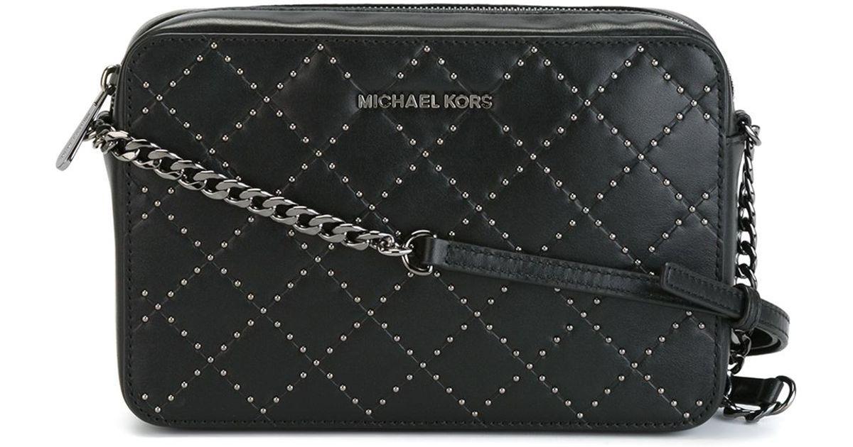 2c7d2700b19ec ... france lyst michael michael kors jet set travel micro stud bag in black  aa4e1 c4e2a
