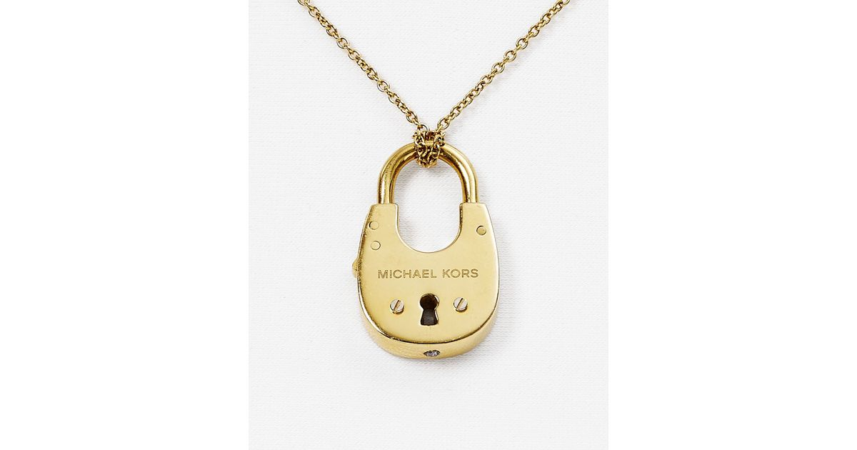 mk interlocking circle pendant asp kors gold pave buy sell logo michael discounted necklace