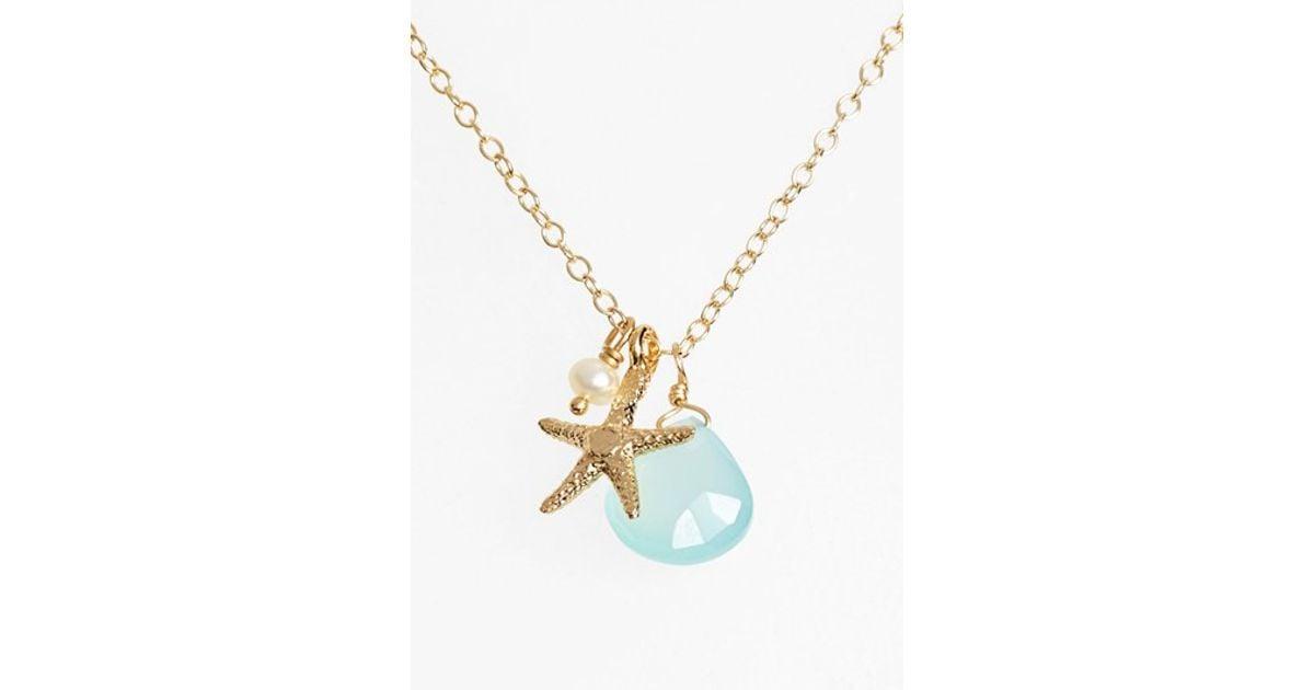 ki ele sea cluster pendant necklace in blue gold