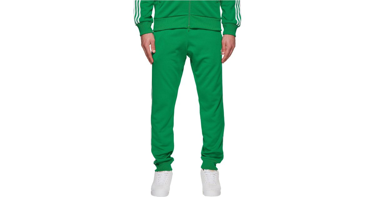 brand new 4d458 83c55 Lyst - adidas Originals Sst Track Pants in Green for Men