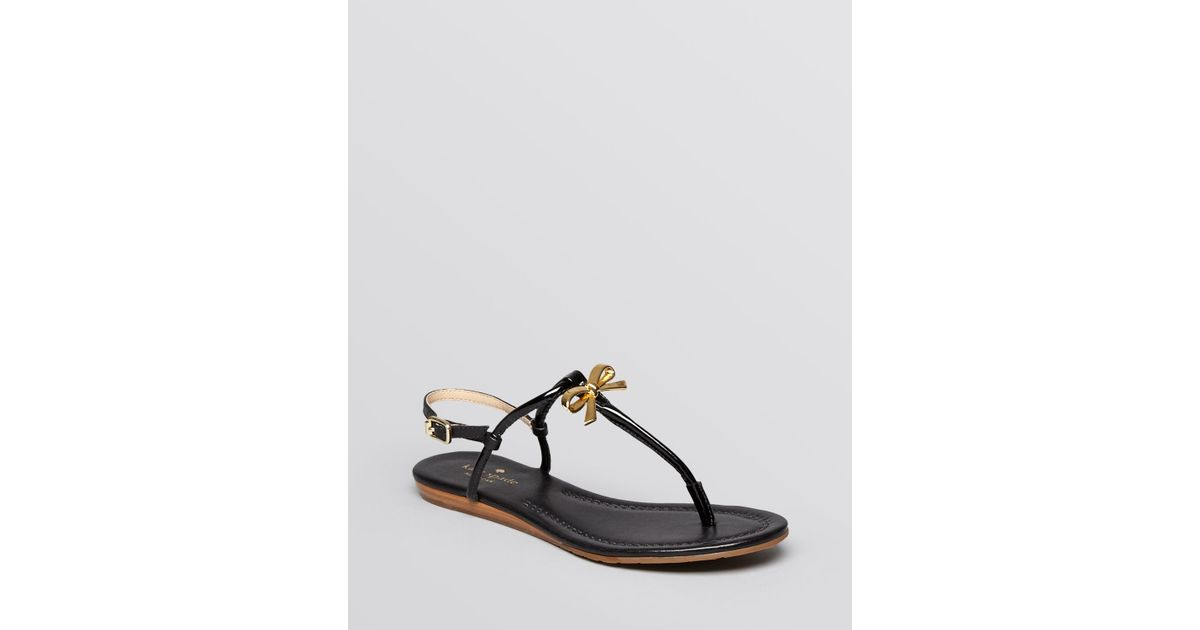 bb3d2373610f Lyst - Kate Spade Flat Thong Sandals Tracie Bow in Black