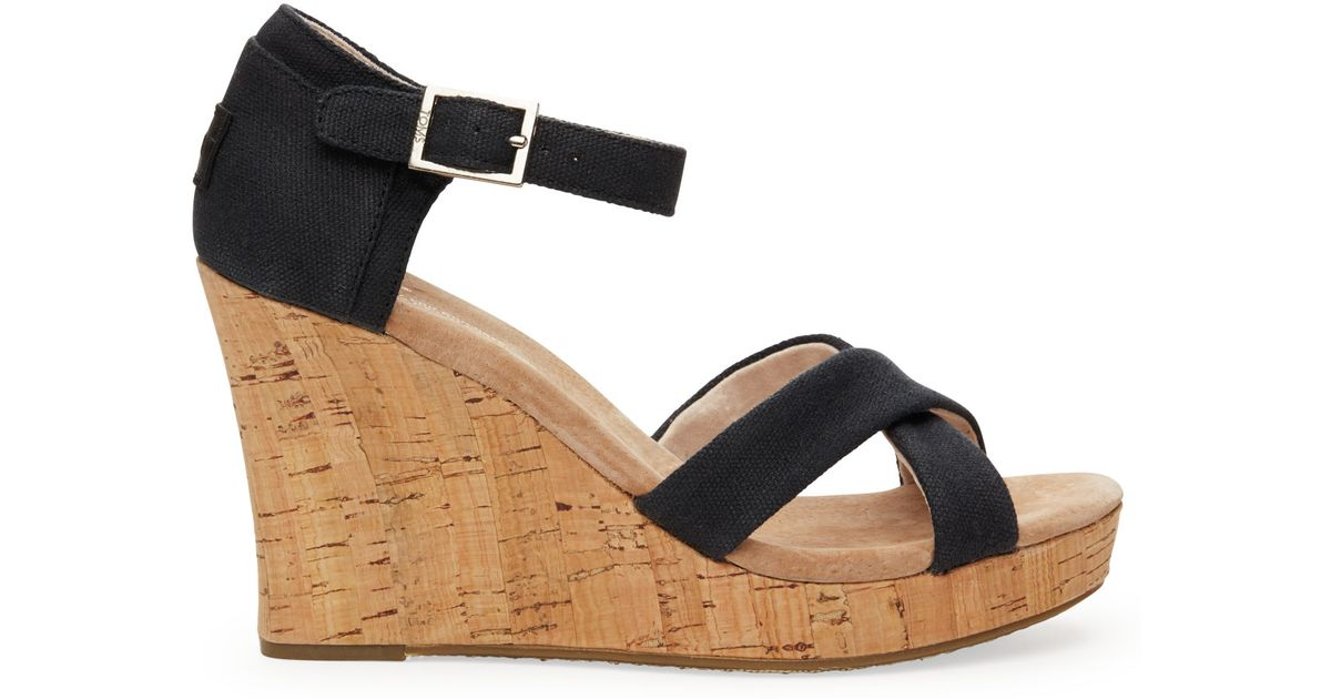 499a21932fc Lyst - TOMS Black Canvas Women s Cork Strappy Wedges in Black
