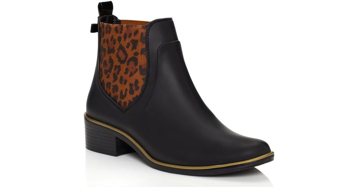 68eeedc9a9fa Lyst - Kate Spade Sedgwick Animal Print Rain Boots in Black