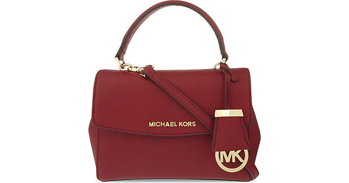 ebc70fa16c37 MICHAEL Michael Kors Ava Extra Small Saffiano Leather Cross Body Bag in Red  - Lyst