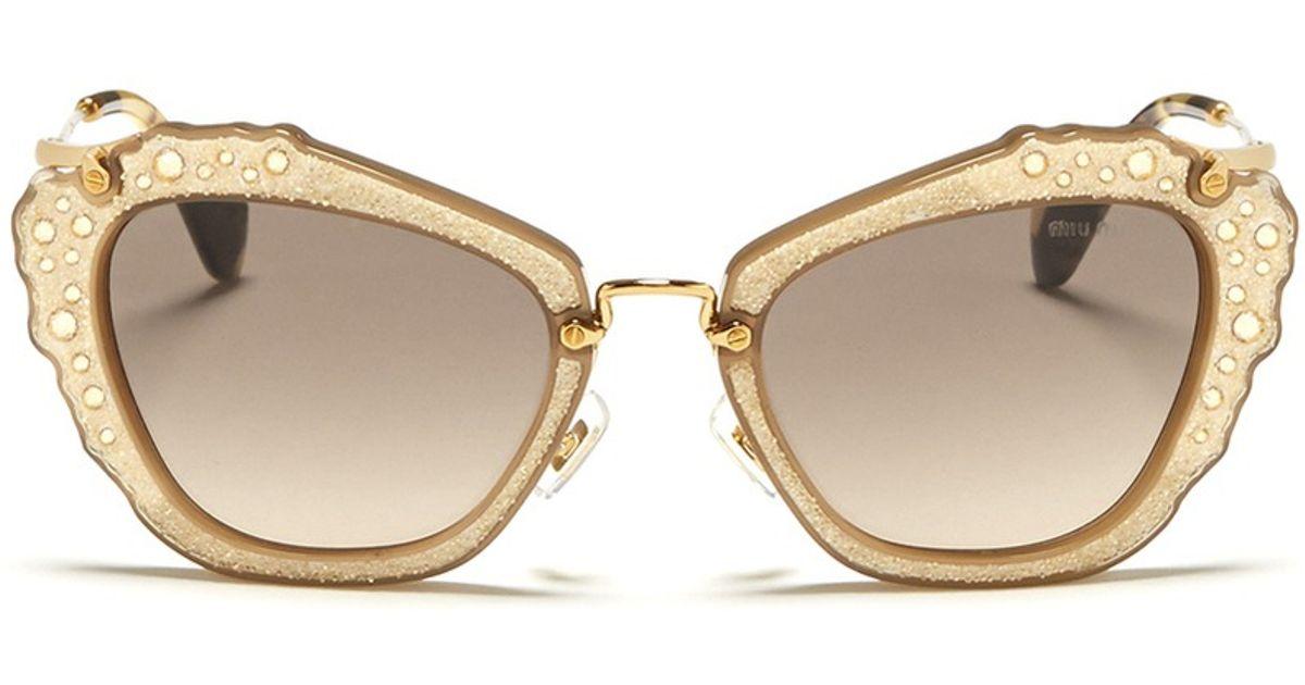abdf7161824 Miu Miu Sunglasses Noir Round