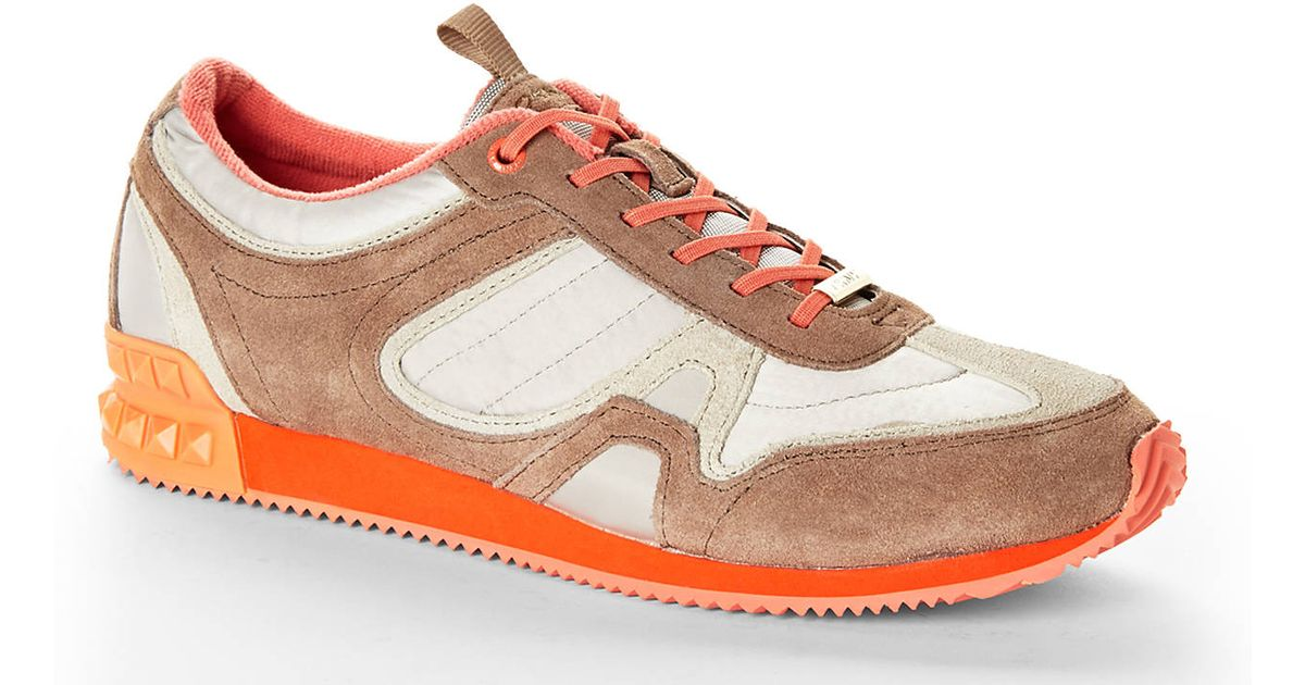 937281005ae6da Lyst - DKNY Taupe Coral Jennie Trainers in Brown