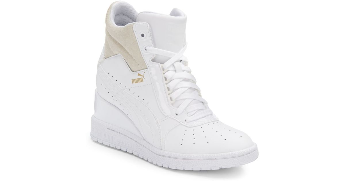 6564864053a7 Lyst - PUMA Advantage Leather Wedge Sneakers in White