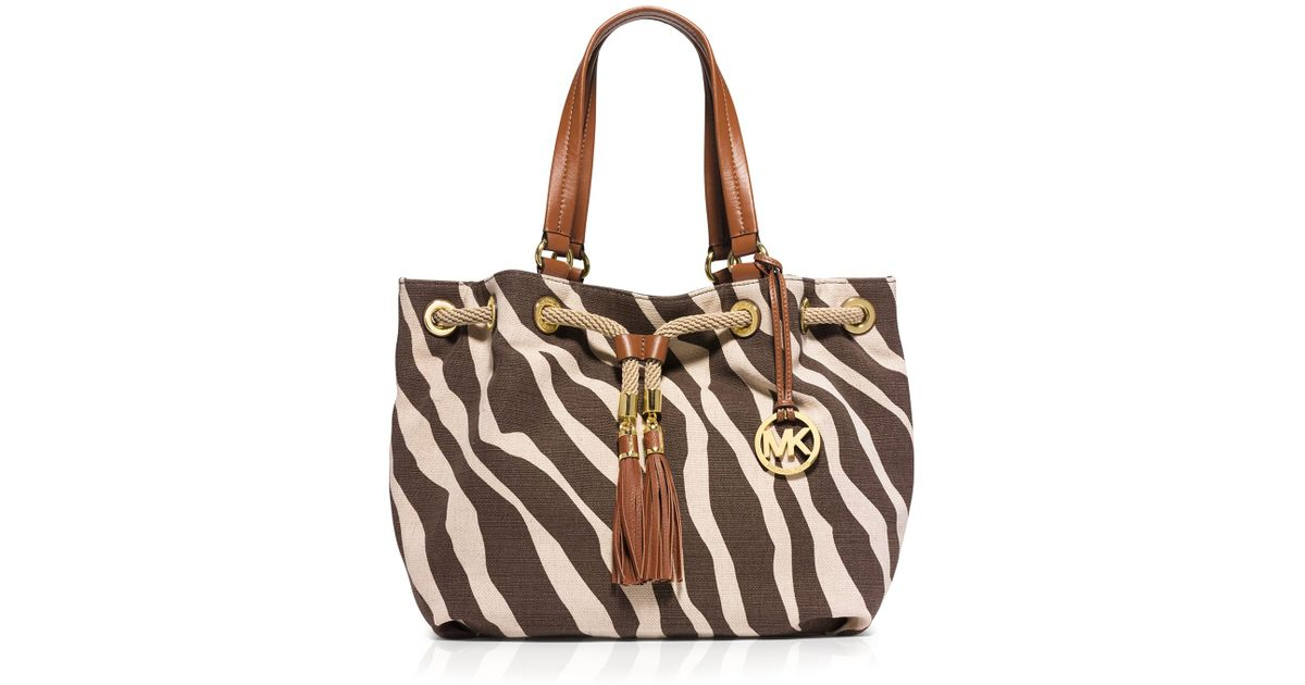 f12a21edaa8e ... official store lyst michael michael kors tote large marina printed jute  canvas 15671 31c2f