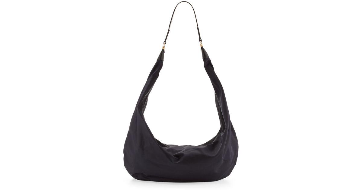 0b7e1762101b Lyst - The Row Sling 19 Nylon Hobo Bag in Blue