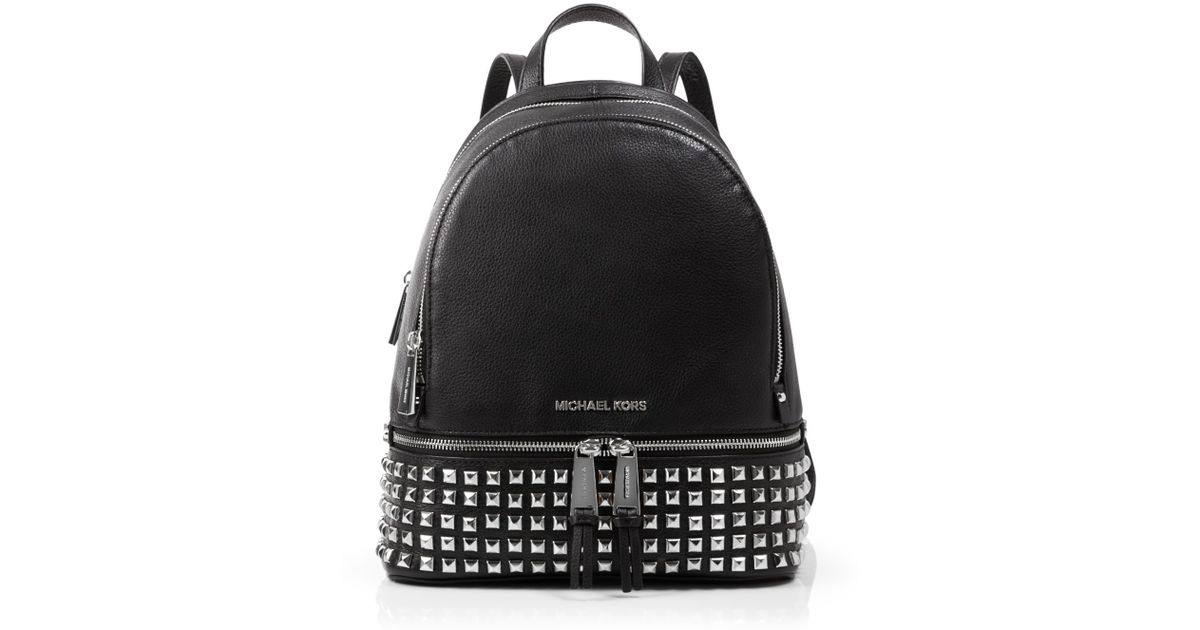 bf6533dd0251 Lyst - MICHAEL Michael Kors Small Rhea Zip Studded Backpack in White