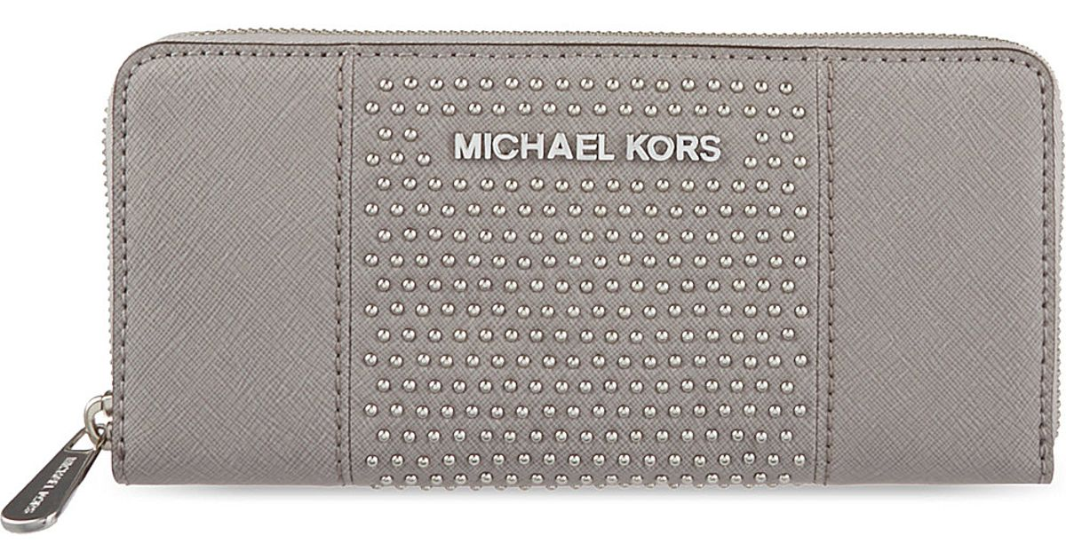 639cf50f37da ... official michael michael kors studded leather purse pearl grey in gray  lyst 81b82 557b3