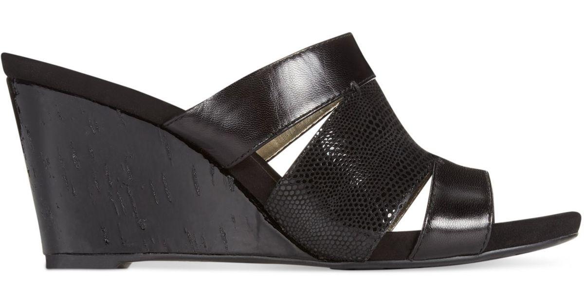 b742aafc65448 Anne Klein Loopy Wedge Sandals in Black - Lyst