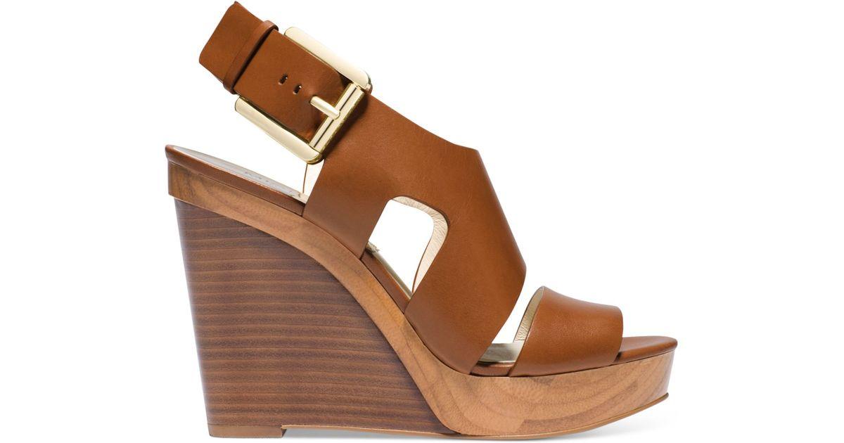 65a88596f76 Lyst - Michael Kors Michael Carla Platform Wedge Sandals in Brown
