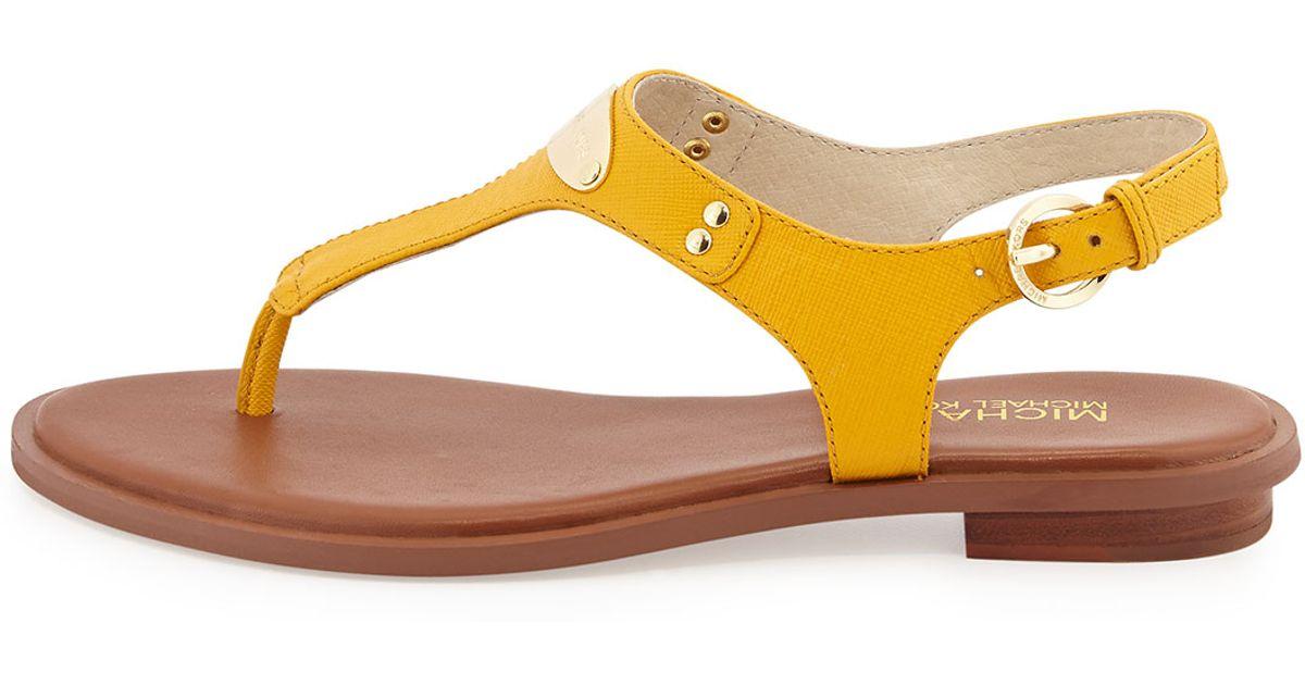 f7669d3e80d9 Lyst - MICHAEL Michael Kors Plate Thong Sandals in Yellow