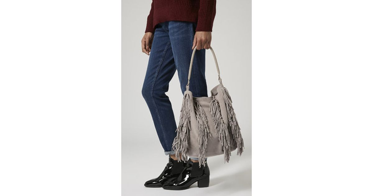 ac518e8121b8 Lyst - TOPSHOP Suede Tassel Hobo Bag in Gray