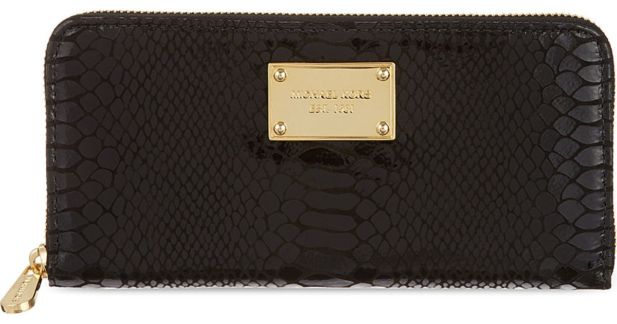 c826f411714a ... Michael Michael Kors Jet Set Python-embossed Continental Wallet in  Black - Lyst ...